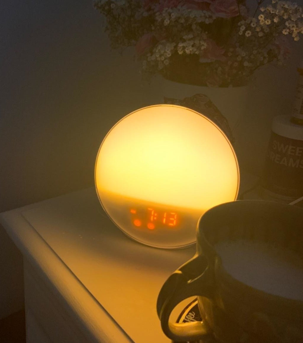 "reviewer photo showing sunrise alarm clock ""lit up"""
