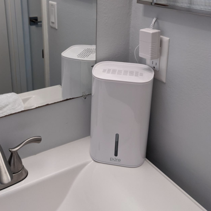 Reviewer humidifier on bathroom sink