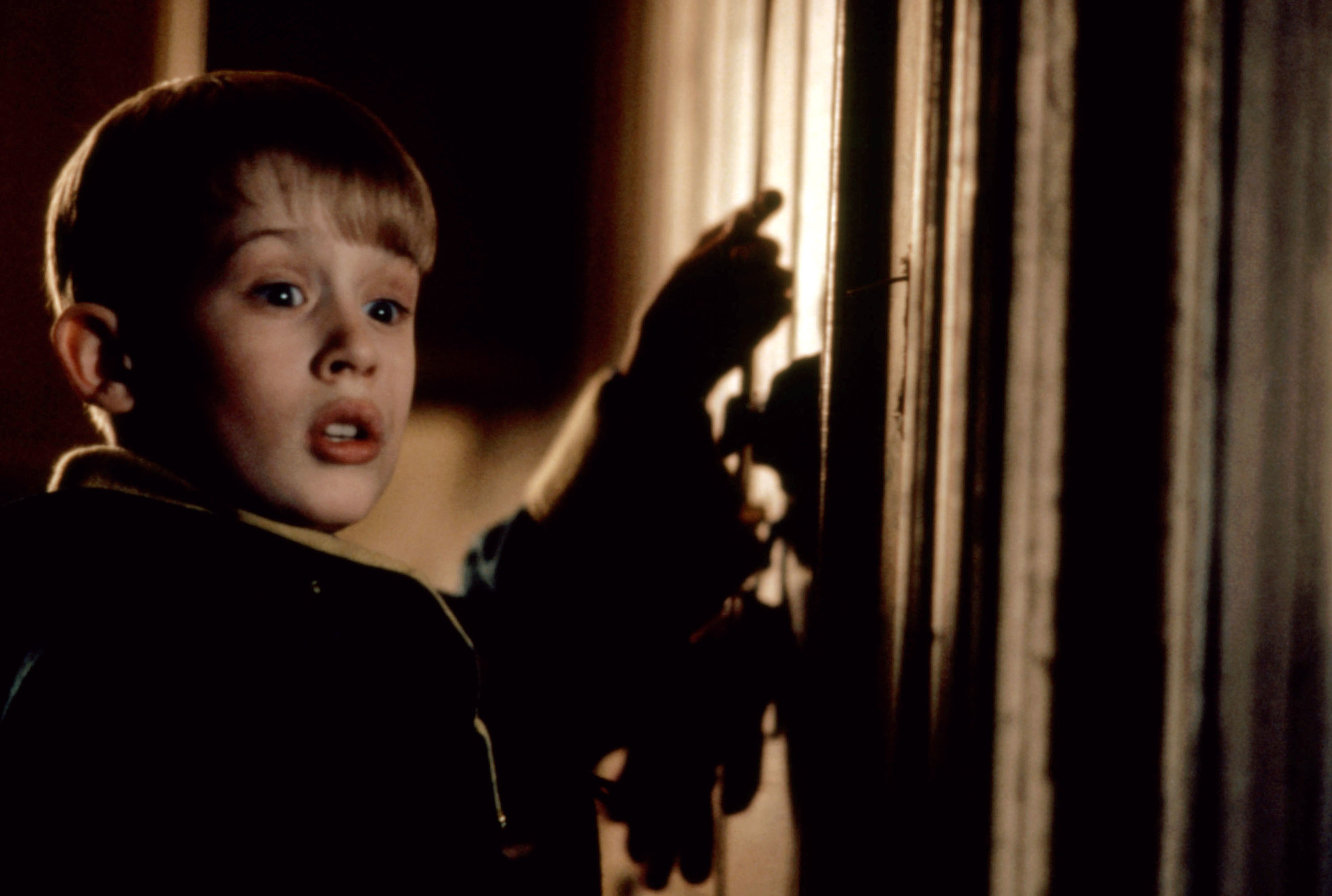 """Macaulay Culkin as Kevin McCallister preparing for a prank in """"Home Alone 2: Lost in New York"""""""