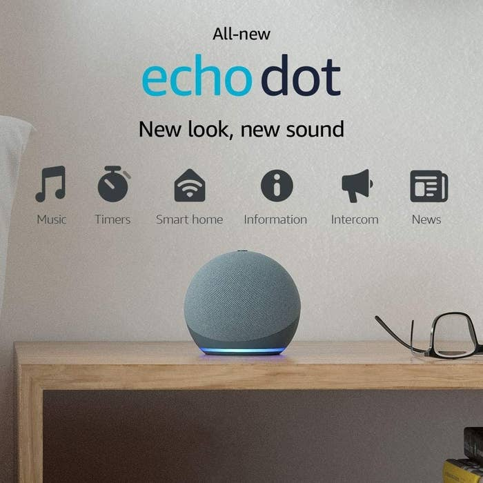 the echo dot in chrome blue sitting on a desk
