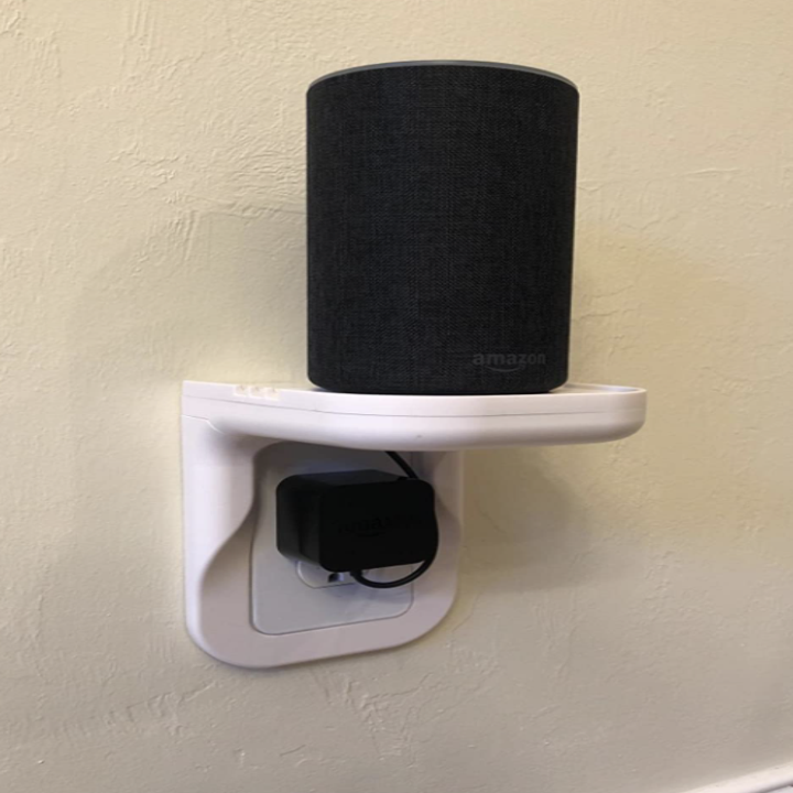 Reviewer wall outlet shelf with device on top