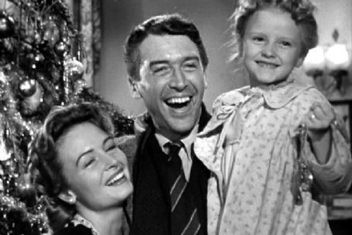 """The cast of """"It's a Wonderful Life"""" smile together during a Christmas scene"""