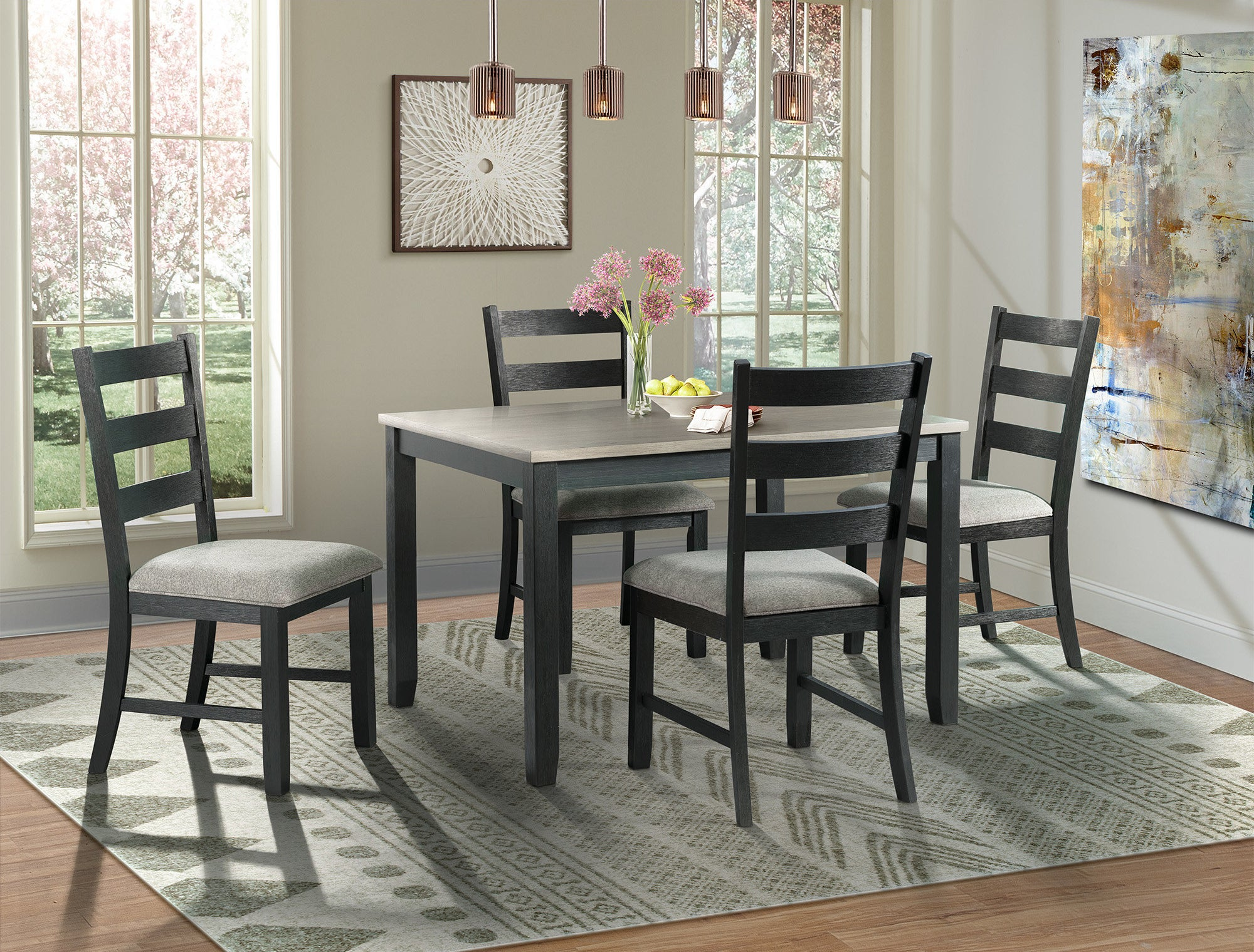 black dining set with padded chairs and a table