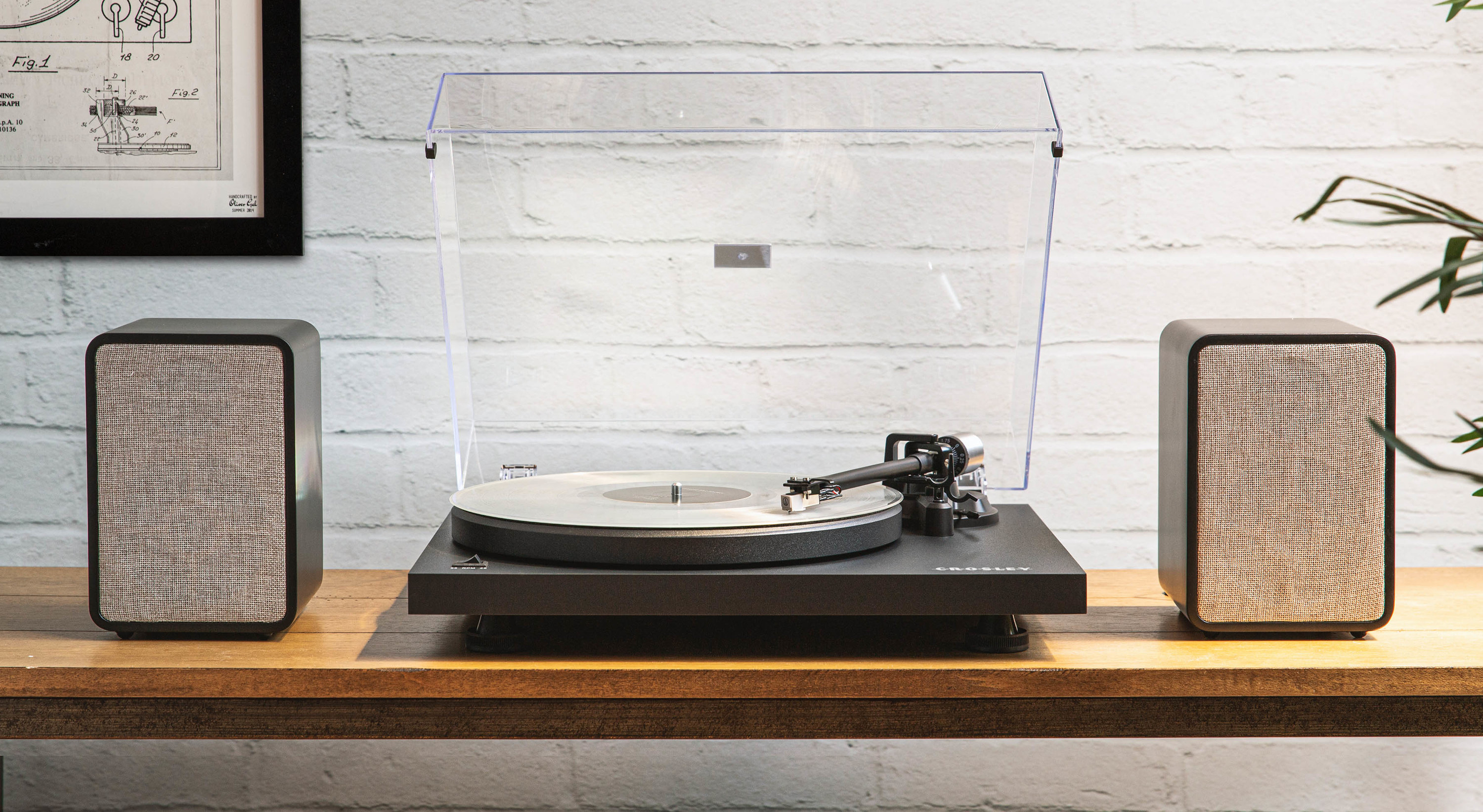 bluetooth vinyl record player with two speakers next to it