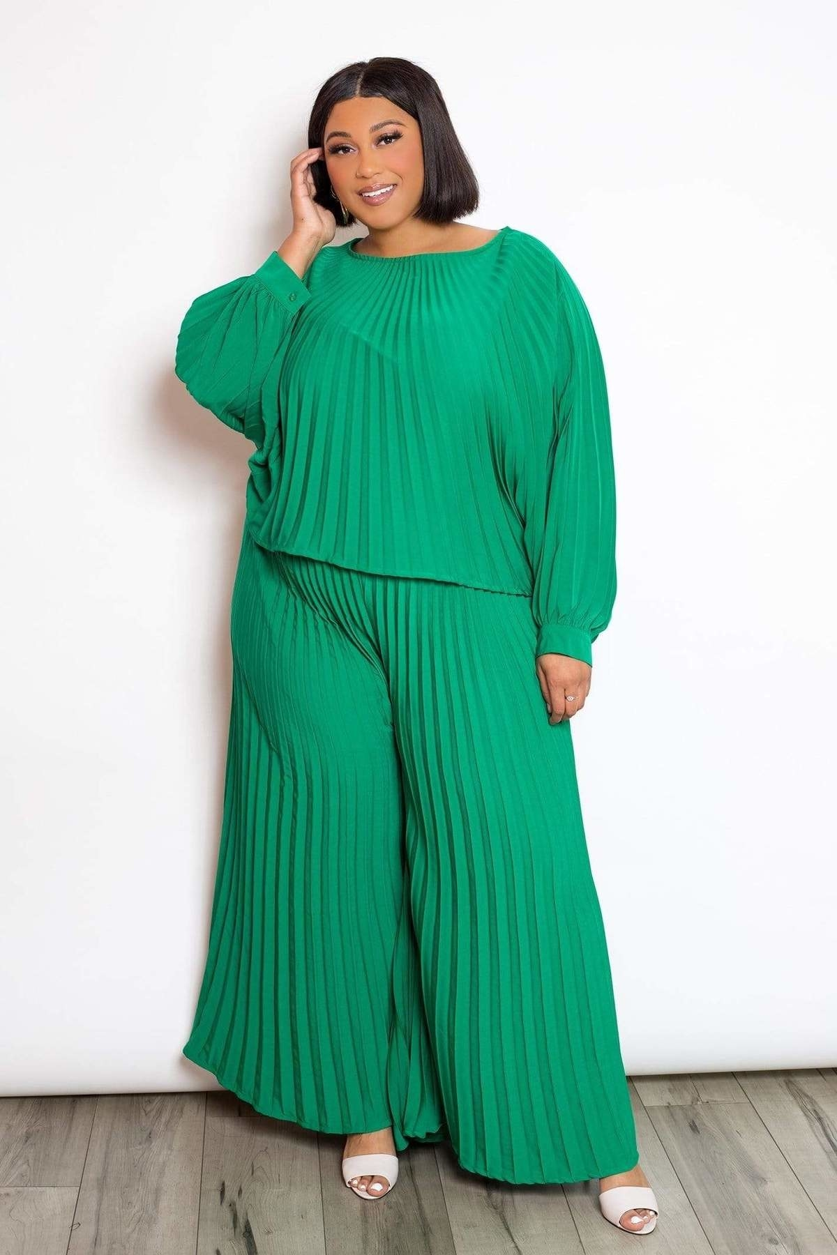 green pleated pants and top