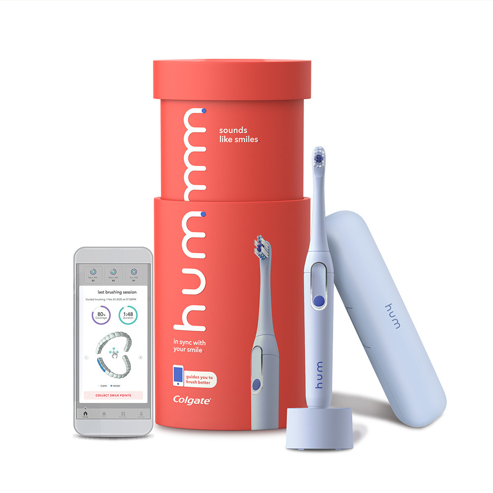 hum electric toothbrush by colgate including charger, toothbrush, and case