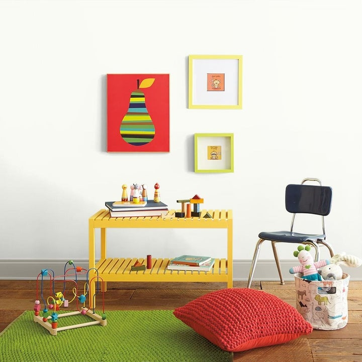 A playroom with white walls