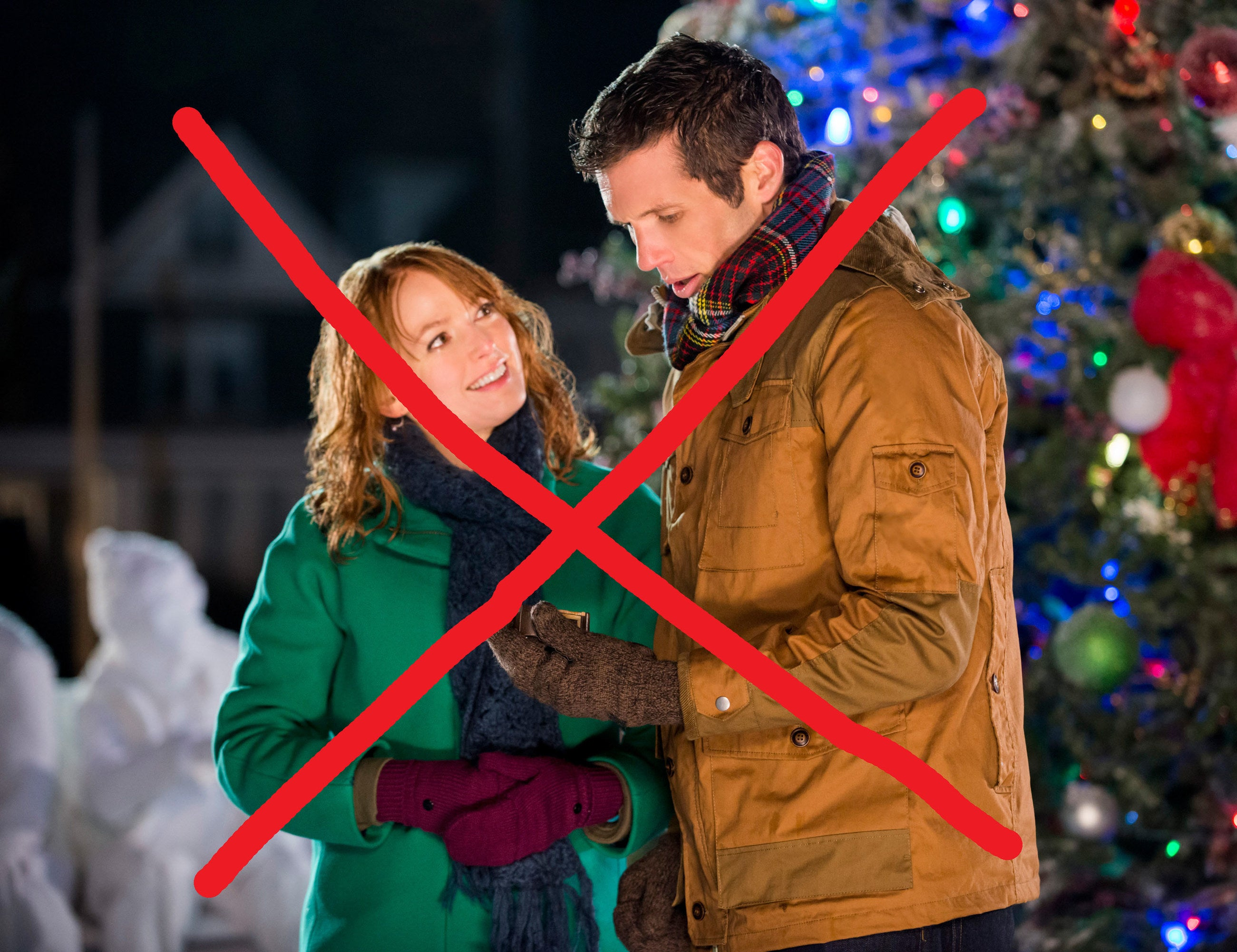 """Alicia Witt and Mark Wiebe in """"A Very Merry Mix-Up,"""" a Hallmark Christmas rom-com"""