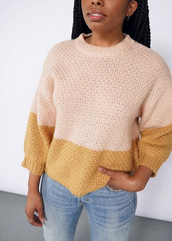 sweater that is horizontally half orange and half peach