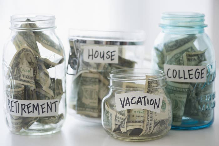 Jars of money for retirement, house, vacation, and college