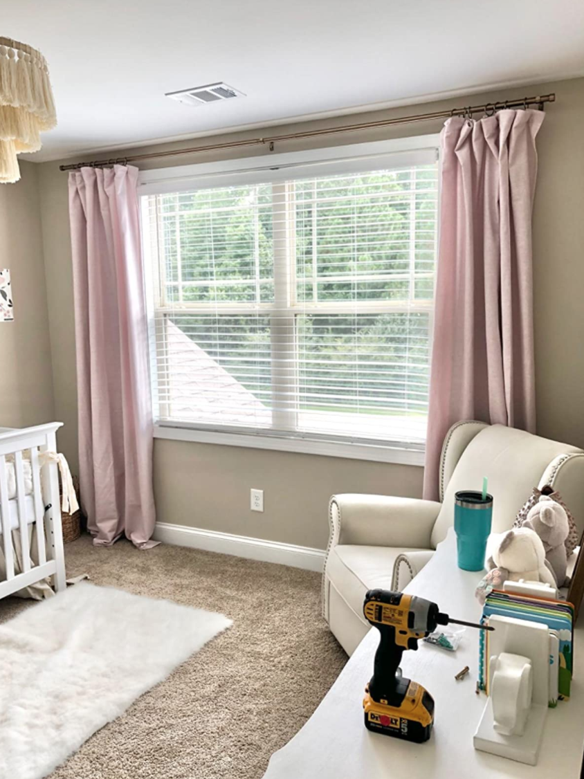 A nursery with the mounted curtains