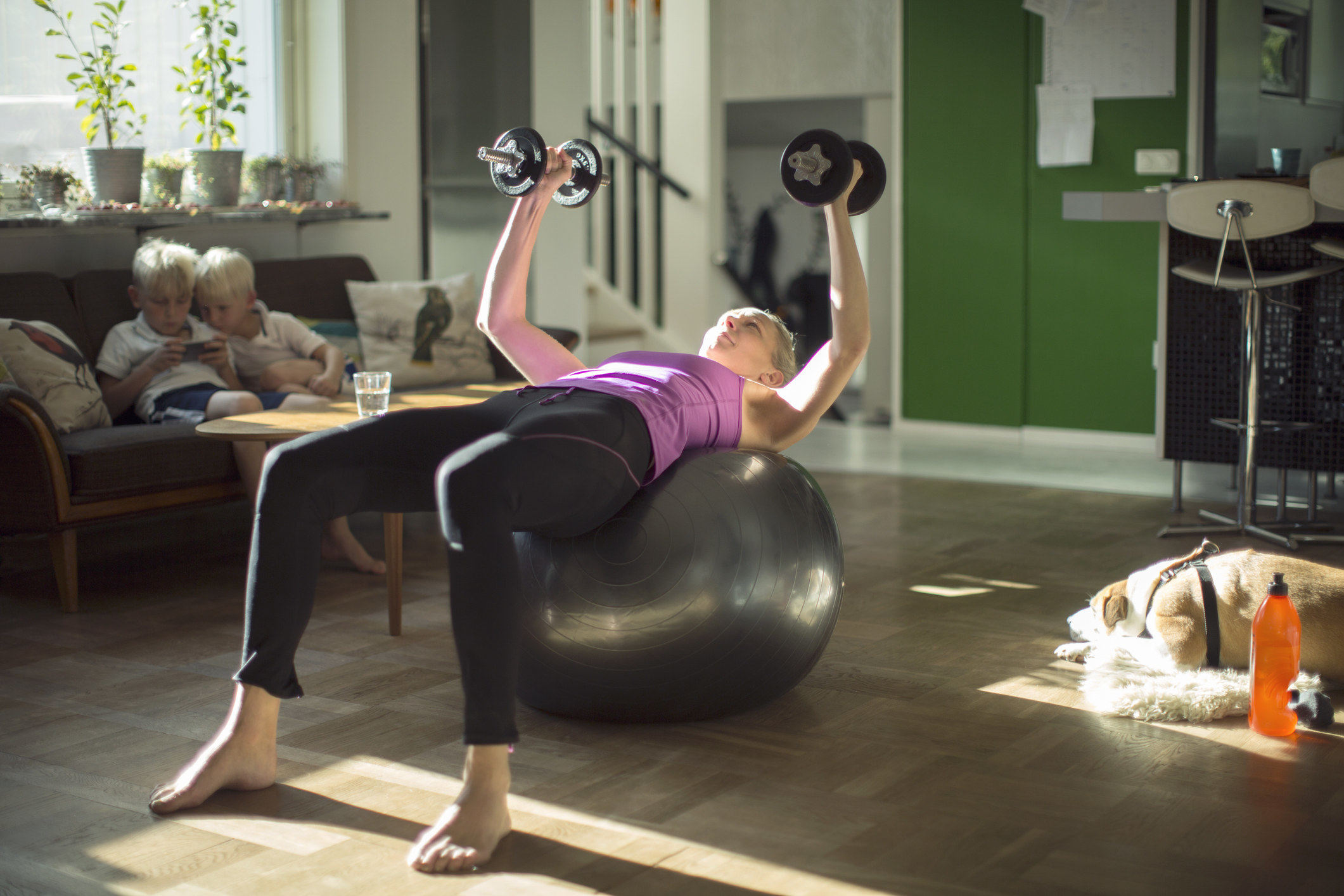 A person using exercise equipment at home in their living room