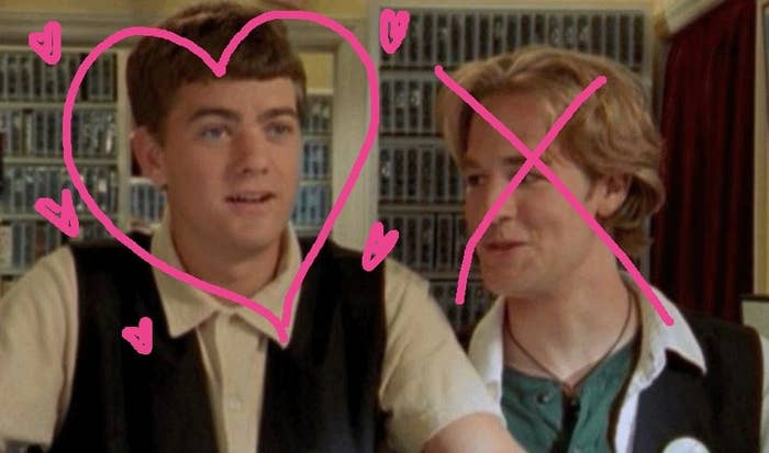 Pacey and Dawson in the video store; a love heart is drawn around Pacey while a cross is over Dawson's face