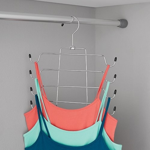 three tank tops hanging on a 4-tiered hanger