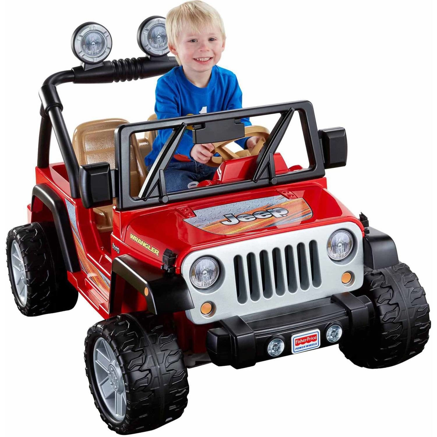 child riding in a red power wheels jeep wrangler toy
