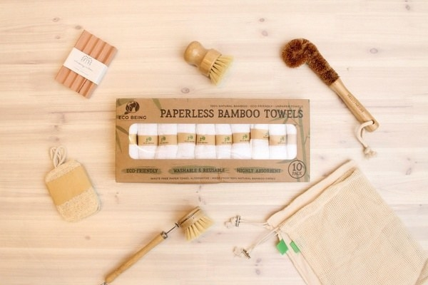three bamboo scrub brushes, a pack of bamboo towels, a scouring pad and reusable bags