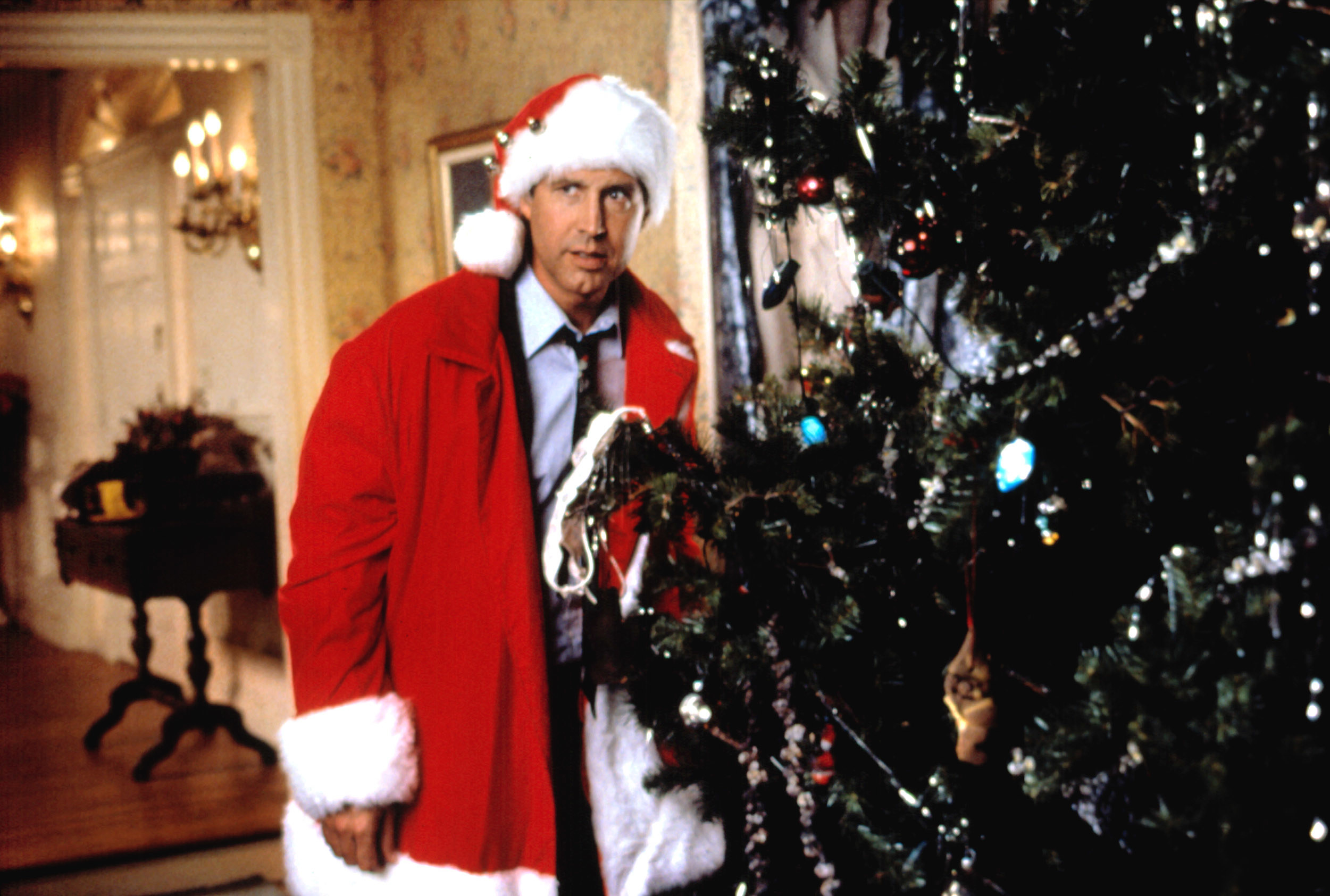 """Chevy Chase in Santa-themed attire in """"National Lampoon's Christmas Vacation"""""""
