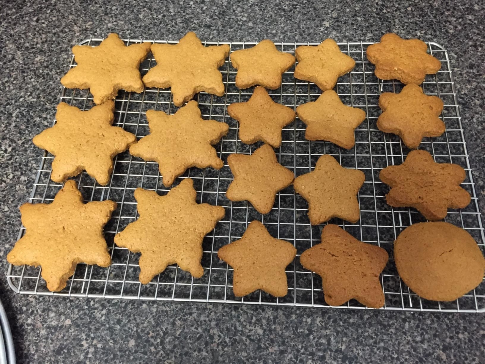 reviewer image of star-shaped and circular cookies on the spring chef cooling rack