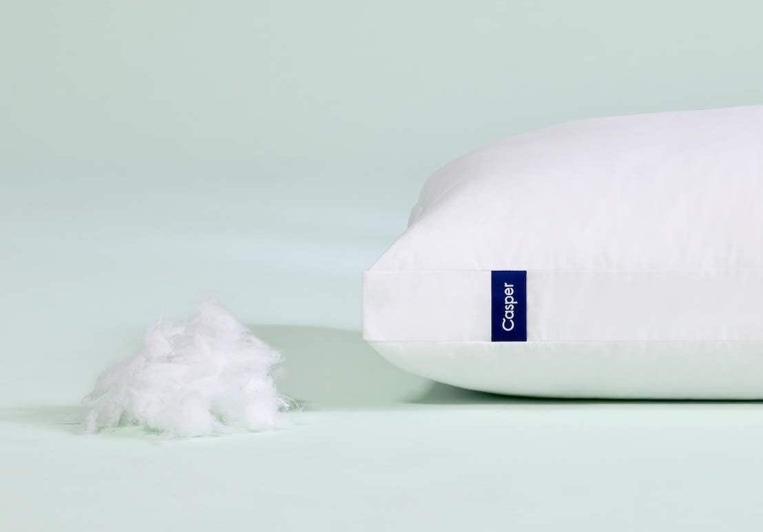 The white pillow next to some of the microfiber filling