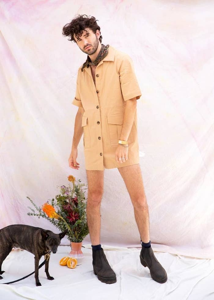 model wears tan dress with big front pockets