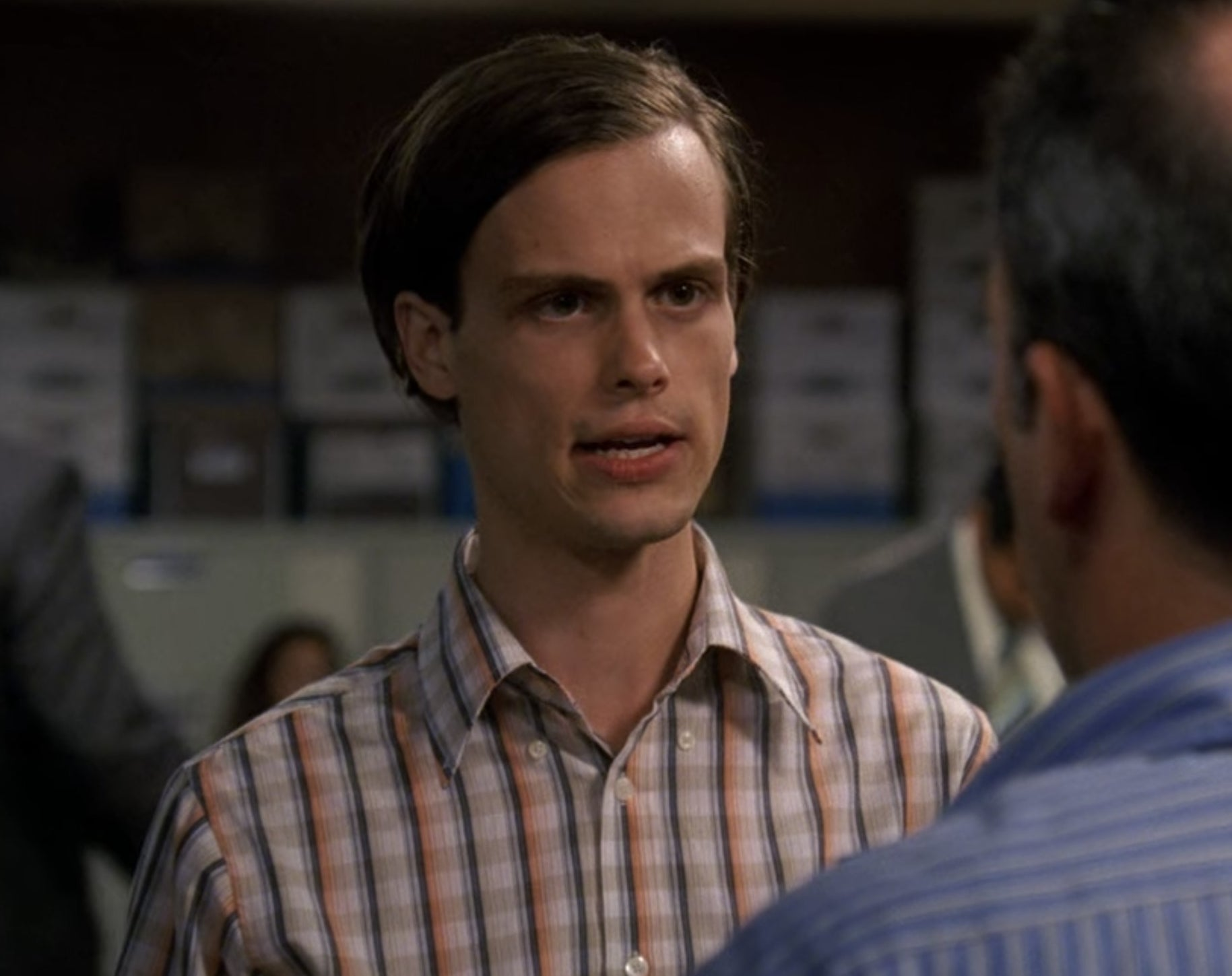 Spencer Reid from Criminal Minds talking to a person