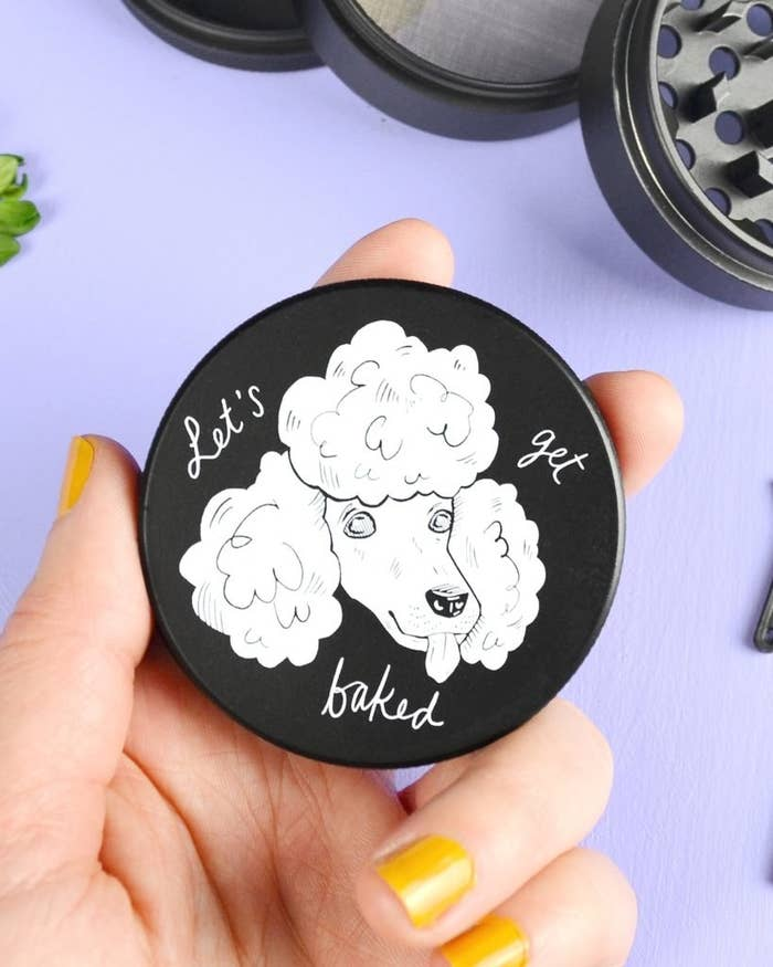 """An image of a grinder for herbs that says """"Let's get baked"""" on it."""