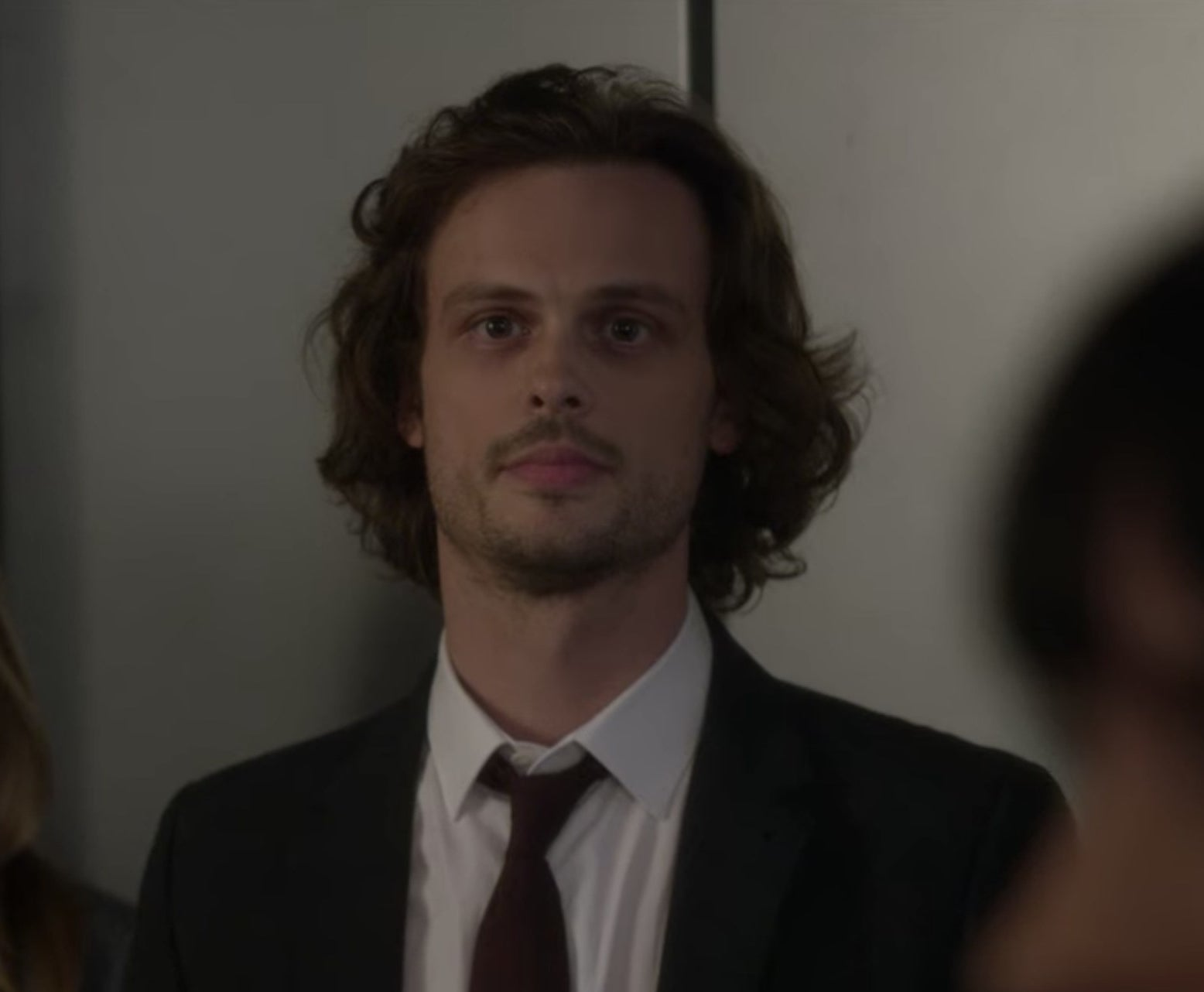 Spencer Reid from Criminal Minds standing next to a person