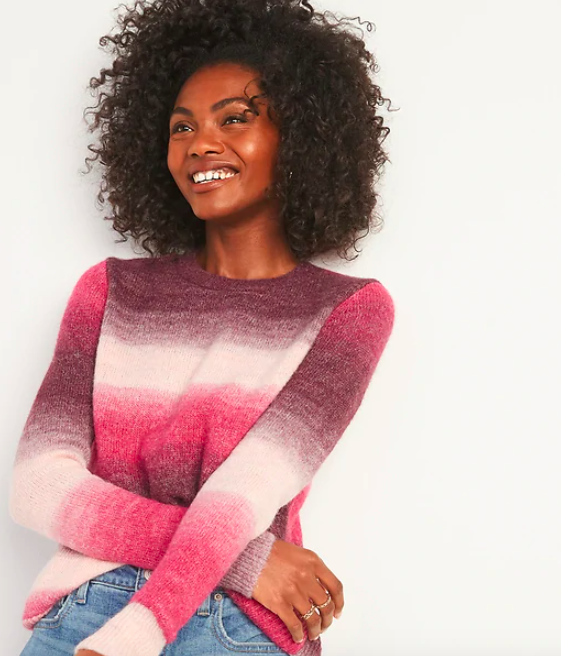 the sweater in a pink to white ombré
