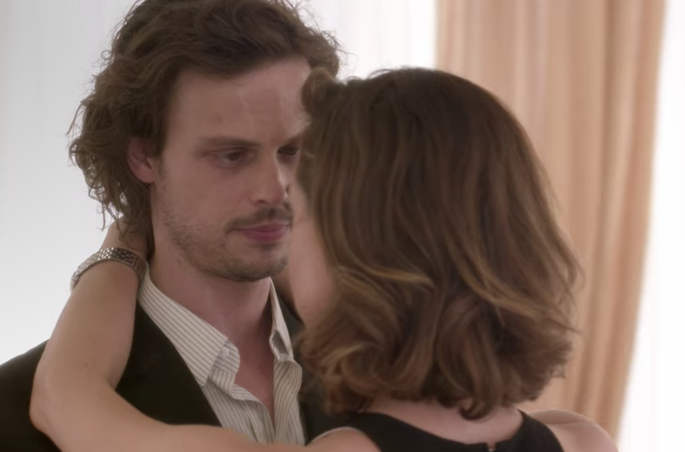 Spencer Reid from Criminal Minds slow dancing with a person