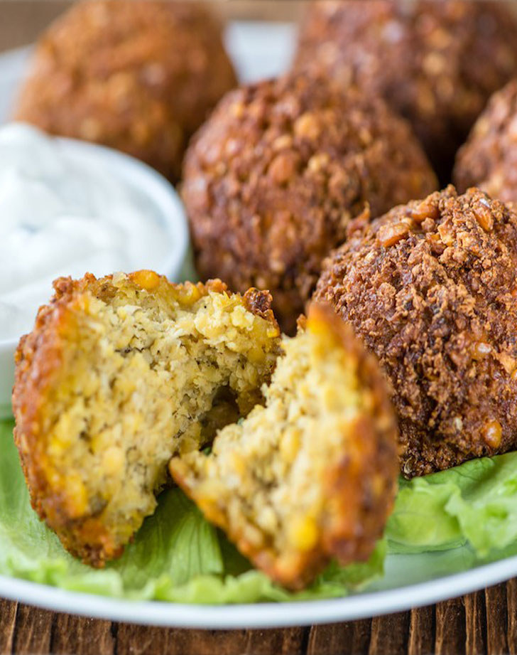 Air fried falafel balls with dipping sauce.