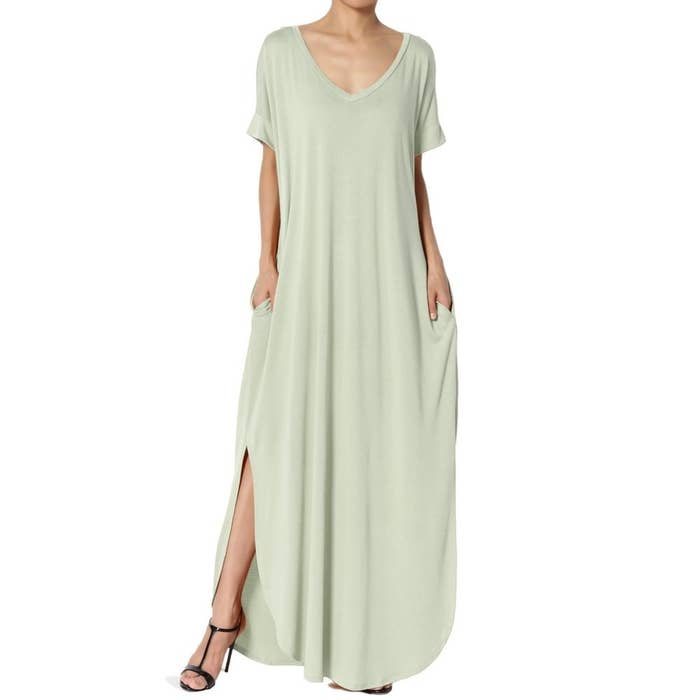 model wears light sage green maxi dress with side slits