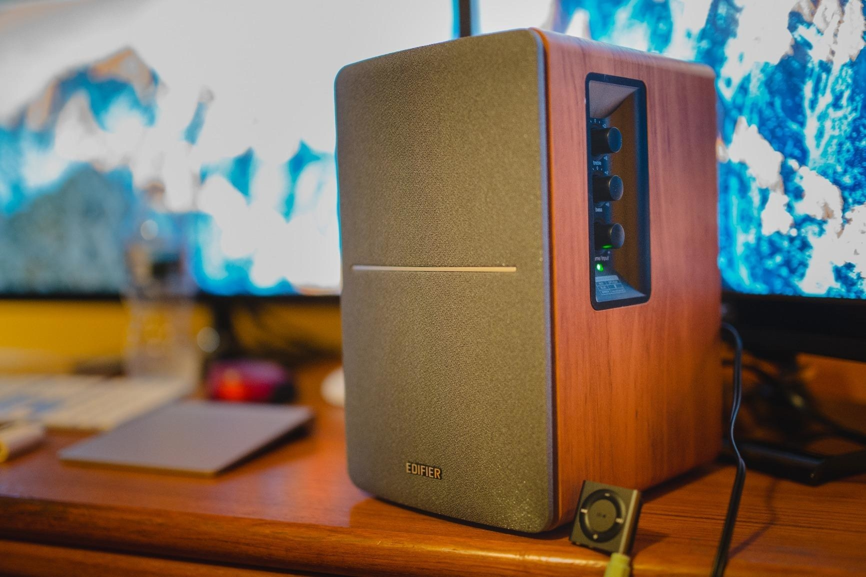 A reviewer's photo of the bookshelf speaker which has wooden sides