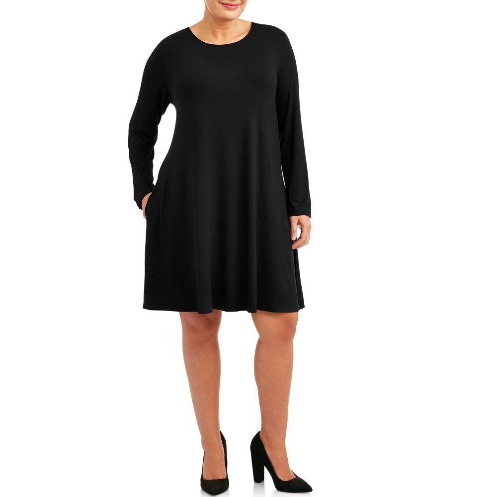 model wears long sleeve black dress with pockets