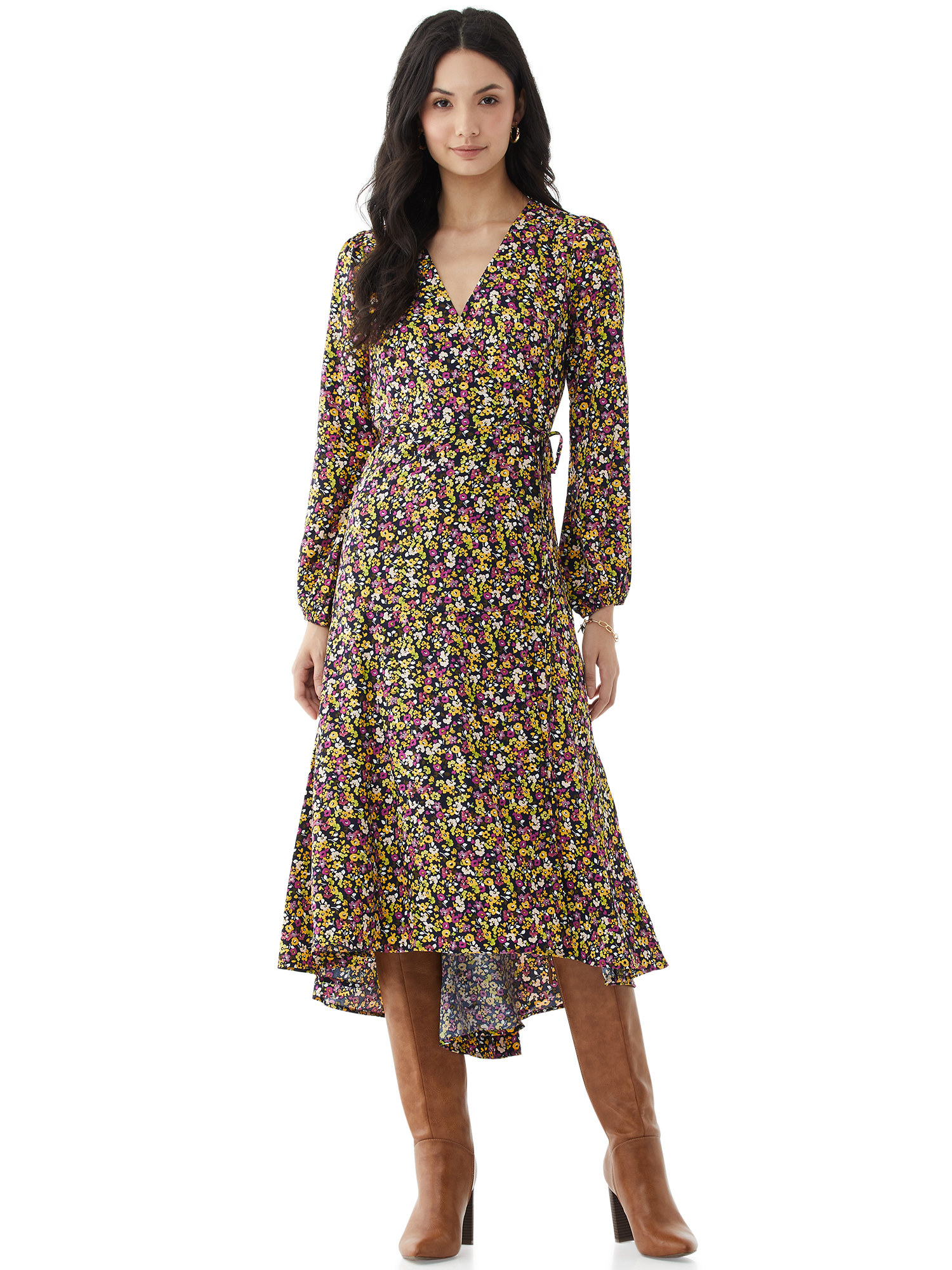 model wears floral wrap dress with knee high brown leather heeled boots