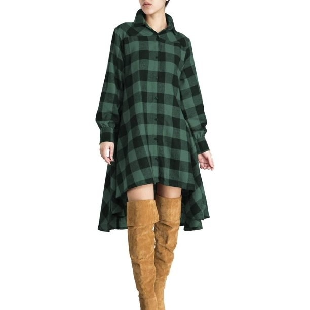 model wears green and black plaid dress with thigh high boots