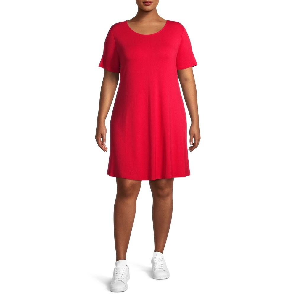 model wears red t shirt dress with white sneakers