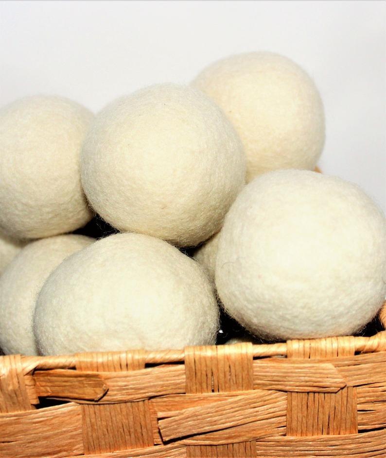 nine wool dyer balls in a basket