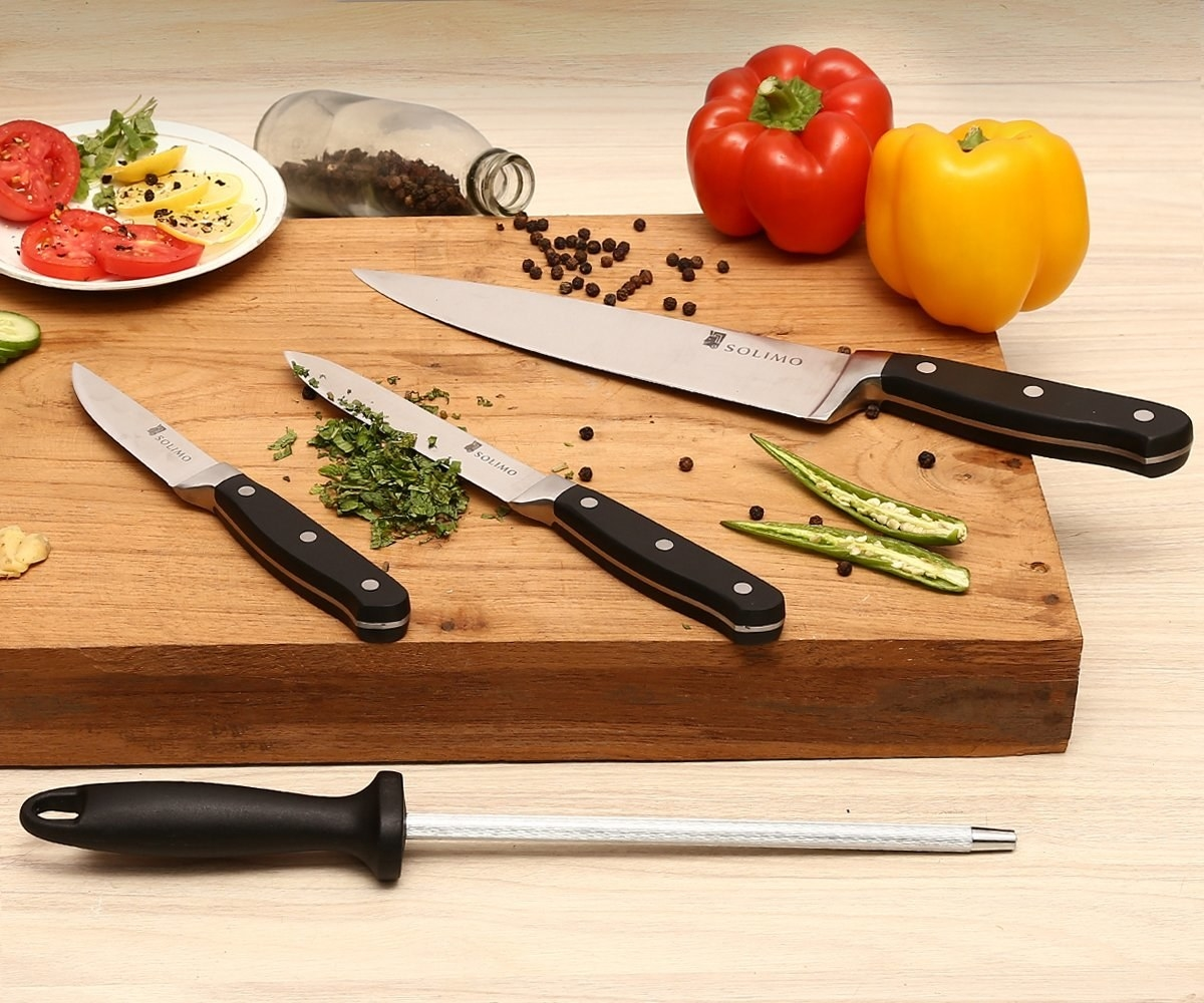 A chef's knife set on a chopping board