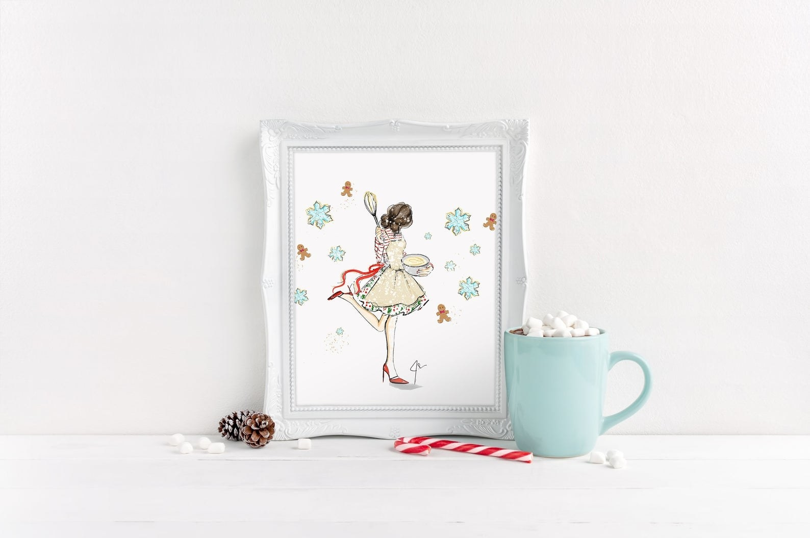 A framed print of a baked holding a bowl of cookie dough and a whisk