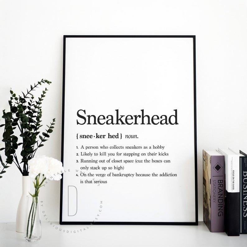 a framed white print that says the definition of a sneakerhead on it in black letters