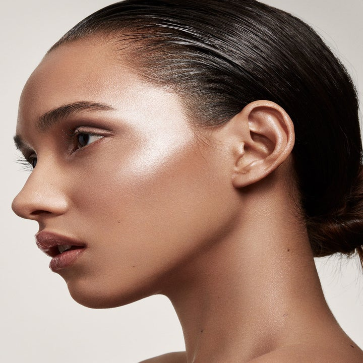 model with tan skin wearing a champagne highlighter