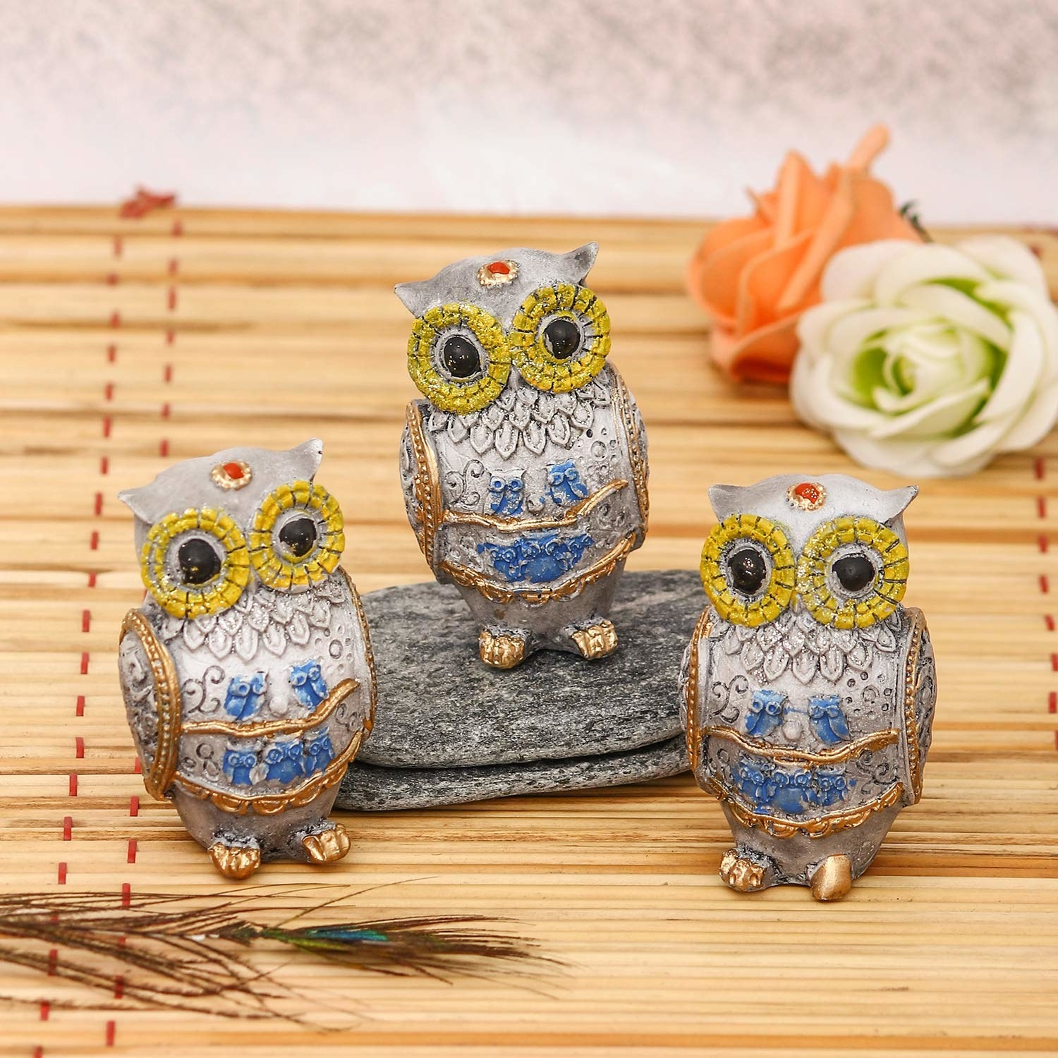 A set of three colourful owls