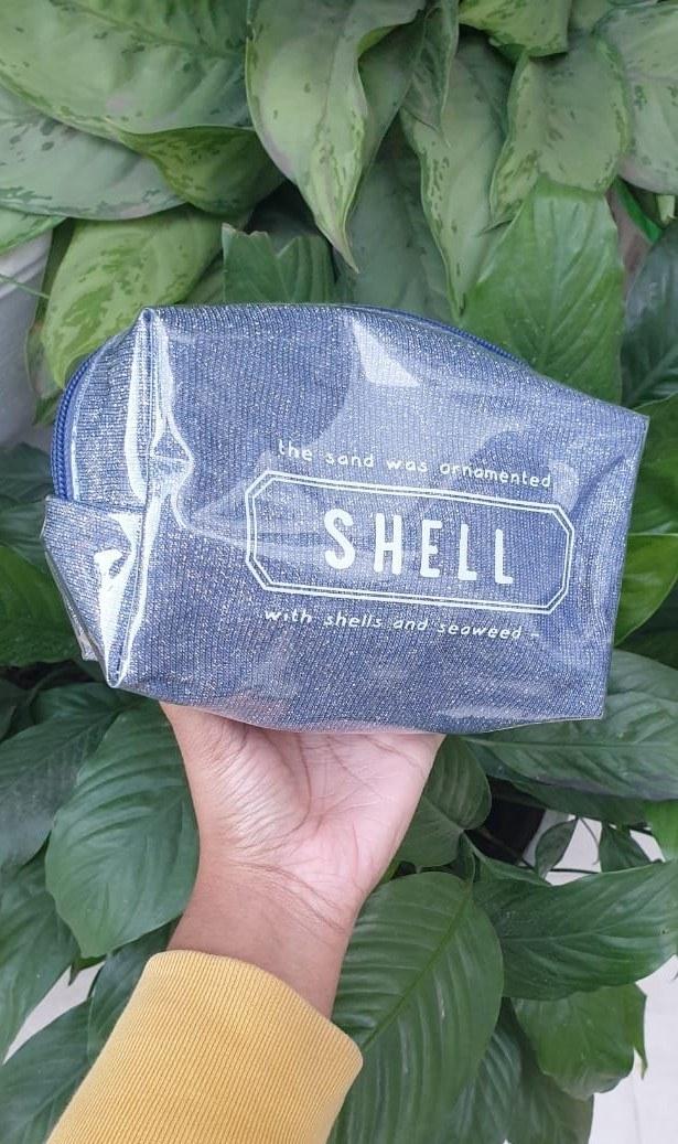 A silver glittery cosmetic bag.