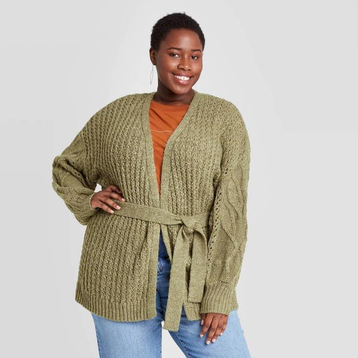 Model in green knit open front cardigan