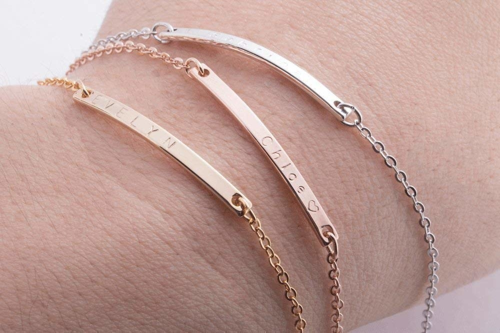 person wearing the three available bracelet finishes — silver, gold, and rose gold