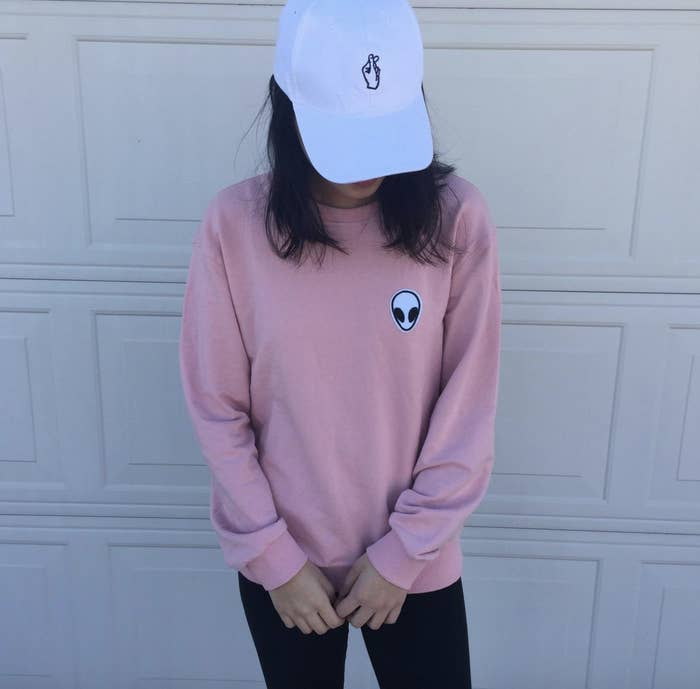 reviewer wearing the pink sweatshirt
