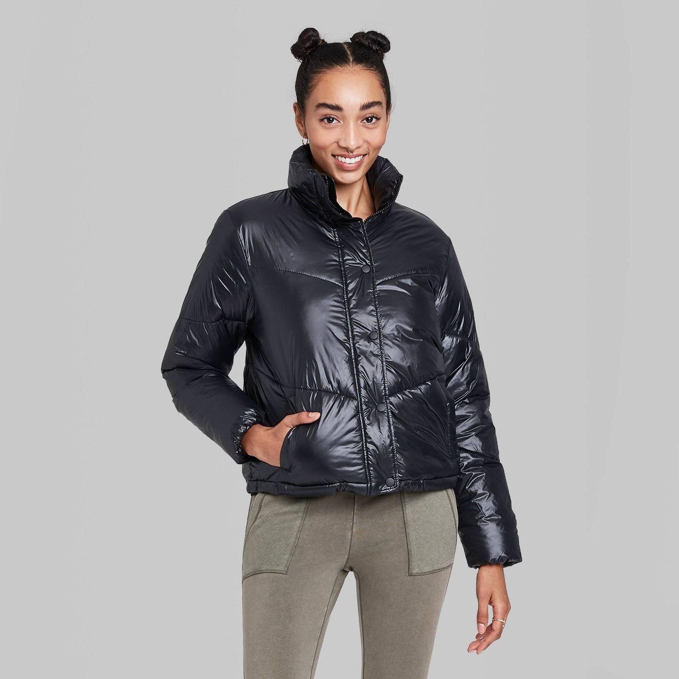 Model in black retro cropped puffer jacket