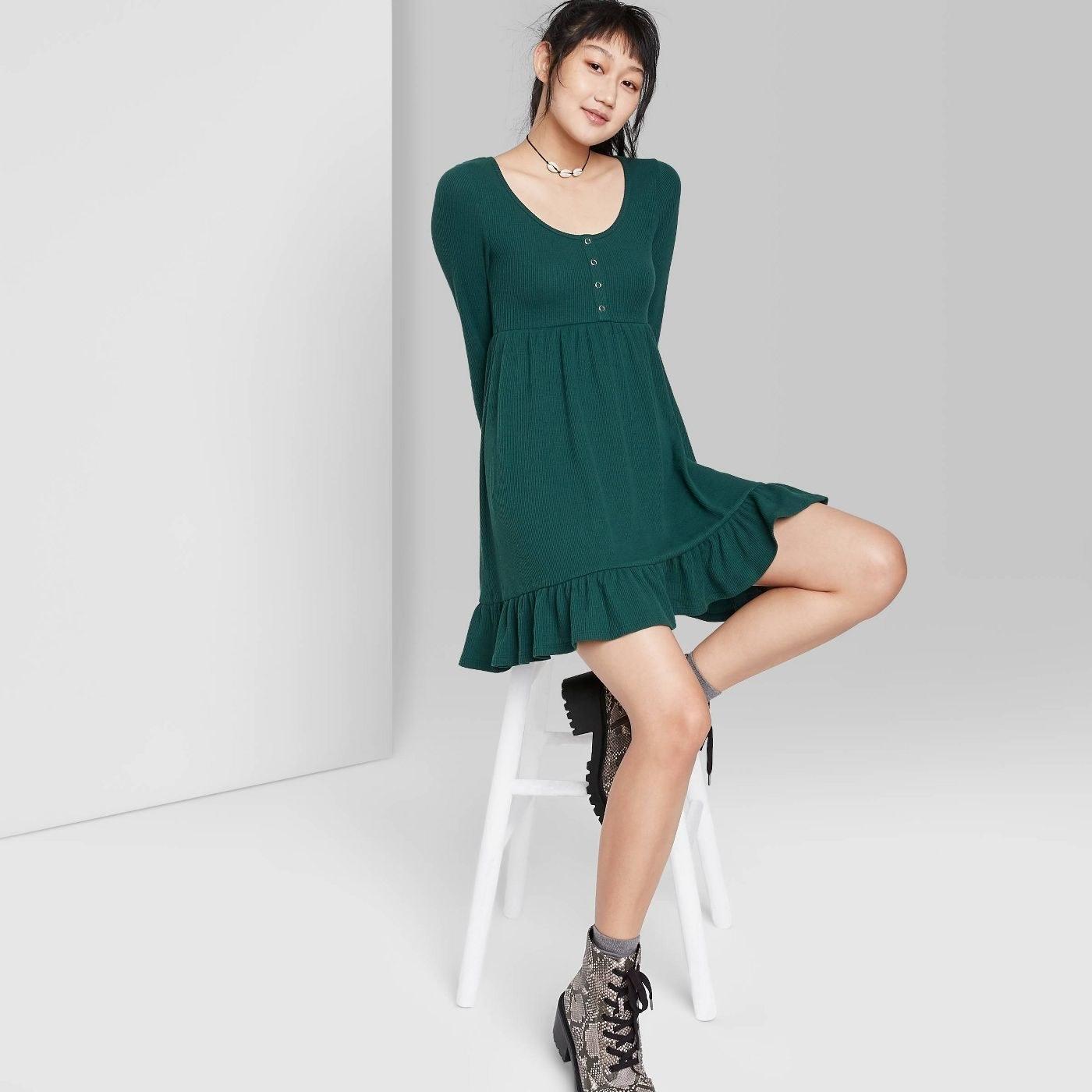 Model in long sleeve waffle knot babydoll dress