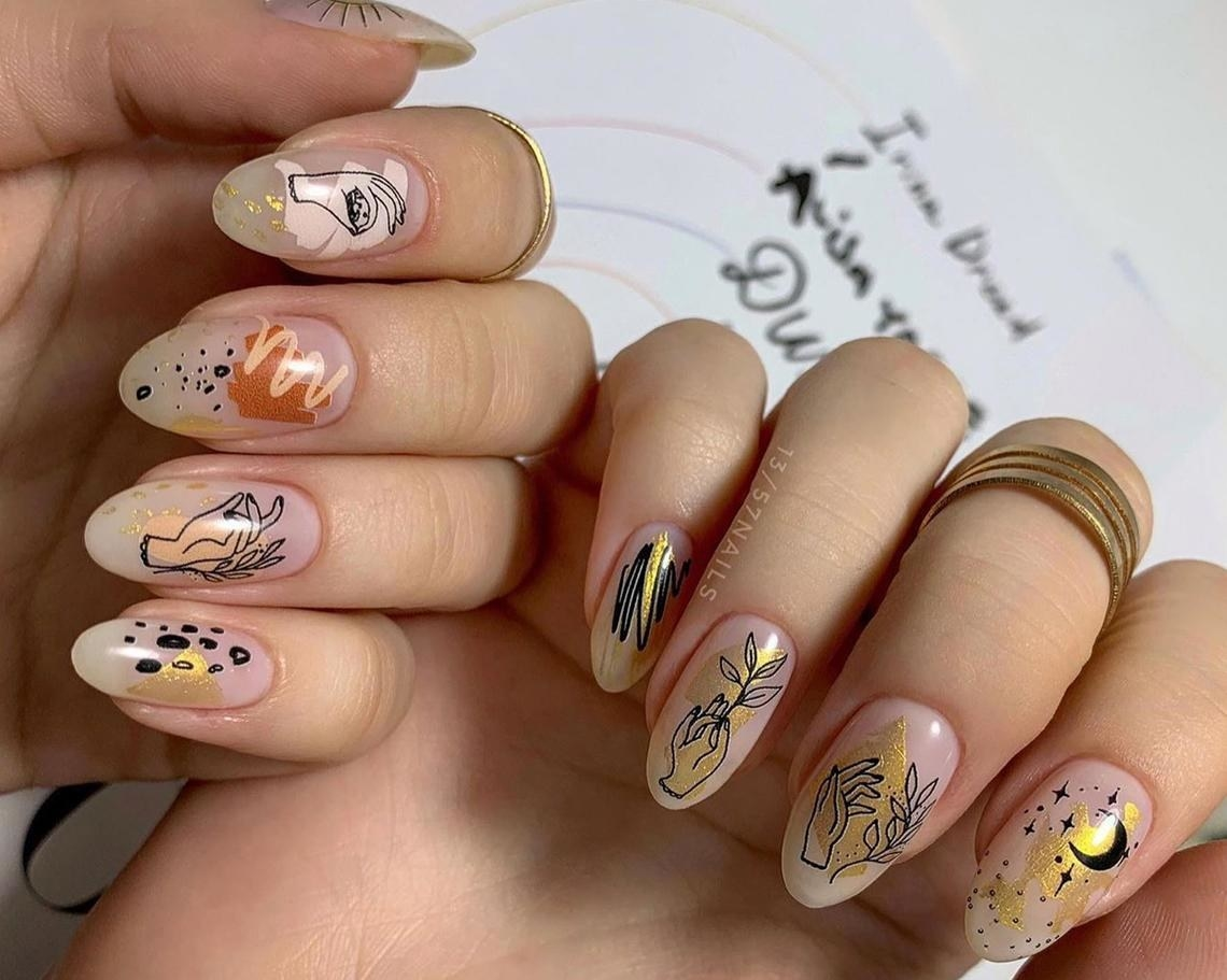 A person wearing the nail decals