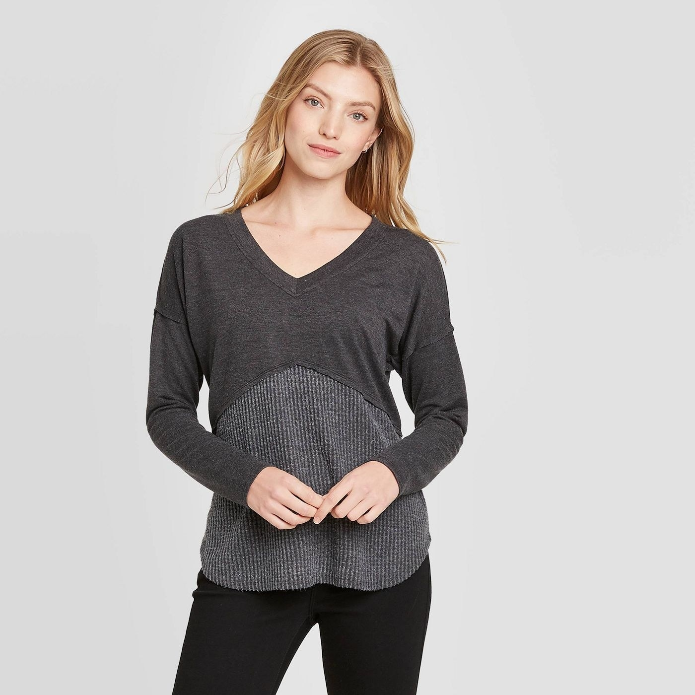 Model in long sleeve tiered top with criss cross back details